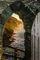 Doorway to Tintagel Castle (CAscotPhotography) Tags: cascotphotography cornwall tintagel legend kingarthur castle englishheritage sea seascape cliff cliffs rocks shore gate door staircase sunset nikon d7100 mixedlighting