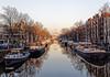 Amsterdam. (alamsterdam) Tags: brouwersgracht canal reflection bridge sunnymorning smoke architecture