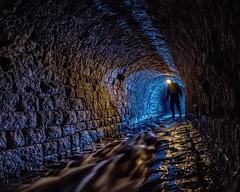 6b - Tunnel Dweller (Robert Hannah) Tags: underground explore water urbanexplore urbex urbexing light lighting lightpainting river atmosphere atmospheric culvert