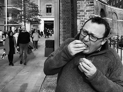 Just cram it all in there (Rob Pearson-Wright) Tags: food eat eating bw blackandwhite candid iphone shotoniphone7 shotoniphone7plus mobilephotography street streetphotography london uk kings road greed man glasses