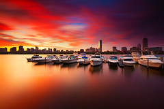 Fiery Sunrise over Boston Skyline and Charles River with Hancock and Prudential Towers, Charles River Yacht Club Cambridge Massachusetts USA (Greg DuBois - Sponsored by LEE Filters) Tags: city longexposure morning pink urban orange usa seascape water yellow boston skyline architecture america sunrise buildings reflections river dark gold golden early dock colorful downtown cityscape waterfront skyscrapers purple unitedstates massachusetts charlesriver newengland wideangle stormy financialdistrict yachts waterblur backbay highrises hancocktower waterreflection bostonskyline waterscape skyfire goldenlight tallbuildings prudentialtower urbanriver goldlight ndfilters dramaticlight cloudmovement newenglandcoast neutraldensity bostonarchitecture bostonphotographer leefilters bostonsunrise backbayboston bostonphotography canon6d graduatedfilters bigstopper charlesriveryachtclub gregdubois littlestopper gregduboisphotography gregduboisboston backbaybostonskyline charlesriversunrise bostonskylinesunrise bostonskylineprints