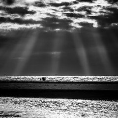 Guarded from above (Frank Busch) Tags: ocean family sea sky people beach netherlands monochrome blackwhite denhaag lightrays kijkduin frankbusch wwwfrankbuschname photobyfrankbusch frankbuschphotography imagebyfrankbusch wwwfrankbuschphoto