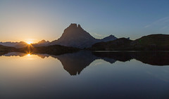 Sunrise over the pic du midi d'Ossau and the Ayous lakes (Ant1_G) Tags: sunset red wild mountain france nature sport rock montagne sunrise landscape spain outdoor hill lac peak hike adventure valley effort reward pyrenees randonnee ossau ayous pyrennees