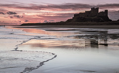 Dawn at Bamburgh 1 (loftylion9) Tags: storm sunrise gales northumberland bamburgh holyisland lindisfarne stmarys blyth amble stmaryslighthouse dunstanburghcastle embleton coquetisland blythbeach lowhauxley bambirghcastle