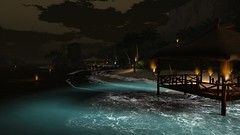 Night Falls On The Lagoon (alexandriabrangwin) Tags: alexandriabrangwin secondlife 3d cgi computer graphics virtual world photography night beach lagoon resort tiki huts water turquoise glow waves foam sea fires floating burning torches calm mood atmosphere