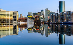 Mirror mirror on the wall, who is the tallest of us all... (Aleem Yousaf) Tags: morning tones cool warm water long exposure canary wharf business district architecture office buildings sunrise reflections glass nikon d800 skyline outdoor city wideangle 1835mm waterfront