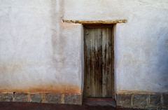 Adobe House (studioferullo) Tags: abstract architecture art beauty bright building city colorful contrast dark decay design detail downtown history historic house light minimalism old outdoor outside patio pretty scene serene tranquil study sunlight texture tone town village weathered white brown door adobe stucco plaster tucson arizona casacordova stone wood courtyard