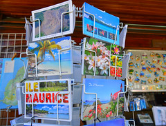 Selling postcards at the store in Mauritius (phuong.sg@gmail.com) Tags: africa buy buying capital casual central coffee color colored colorful colors landmark landmarks logo man mauritius portlouis postcard postcards poster posters price prices sell selling shop shopping shops square stand sticker stickers store symbol symbols tourism tourist touristic tourists travel traveller travellers