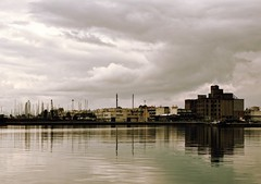 Landscape of K-town // the industrial side (kallchar) Tags: sea reflection landscape waterscape industrial side kalamata greece ocean clouds harmony flickr olympus olympusomdem10