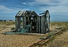 Off The Rails... (DawnWarrior) Tags: dungeness shack fishing net narrow gauge railway line horizon boat shingle clouds nuclear power station nature reserve dawnwarrior sigma debris scrap decay burnt burned abandoned