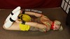 Kamilla Hogtied and Gagged with Bondage Tape (Fanta_Productions) Tags: socks bondage struggling shortshorts boundandgagged kneehighsocks damselindistress bondagetape hogtied sockfetish tapegag videoscreenshot bondagecuffs