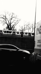 Busy commute (williamw60640) Tags: trees blackandwhite bus car traffic rushhour treebranches commuters elevatedtrain chicagotransitauthority jfkexpressway ctaelevatedtrain