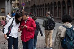 Information at fingertips (paul indigo) Tags: travel portrait man tourism mobile lady phone belgium brugge streetphotography bruges information paulindigo