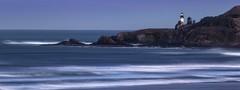 Yaquina Head Lighthouse (Mstraite) Tags: light lighthouse beach ocean landscape water waves blur rocks oregon coast canon tripod flickrtravelaward