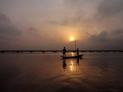 moments for reflection (dotun55) Tags: lagos nigeria travelphotography outdoor fishermen canoe thirdmainlandbridge bridge sunrise silhouette sonydscwx80 carlzeiss sony lens africa