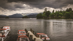 A cloudy Windermere. (Ian Emerson) Tags: windermere lakedistrict cumbria lake mountains hillls water boats trees outdoor england landscape stormy clouds jetty sunlight light