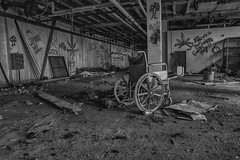 Roll Me Away On The Freedom Train (Brian Rome Photography) Tags: travel building abandoned hospital wheelchair debris naturallight indoor tagged dirt urbanexploration graffitti exploration discovery tagging derelict deserted urbex cinderclock