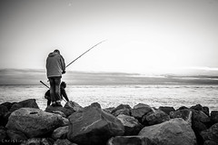 Les Saintes Maries de la Mer (Christine Seiler Photography) Tags: sea blackandwhite france landscape coast seaside fishing schwarzweiss fischer sdfrankreich camargue southernfrance angler lessaintesmariesdelamer