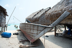 Old wood boat on morgan village island (leykladay) Tags: ocean wood travel sea vacation sky house holiday plant tree tourism beach water landscape asian thailand island boat wooden fishing sand colorful asia long village natural bright tail scenic lifestyle scene location islander exotic hut journey transportation thai tropical destination tropic sailor morgan koh gypsie surin andaman seafaring longtailed