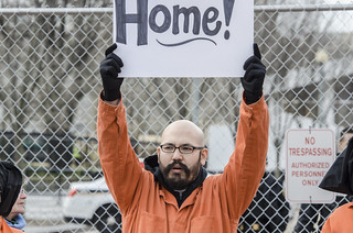 Marc Alvarado Holds a Sign at a Protest to Close Guantánamo