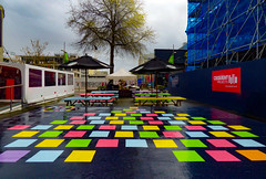 Migrating Colours (Steve Taylor (Photography)) Tags: art design architecture bench table colourful newzealand nz southisland canterbury christchurch city cbd tree perspective square cequentprojects umbrella scaffold scaffolding spring