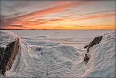 Vintersolnedgång (Jonas Thomén) Tags: sunset solnedgång vinter winter snö snow sea hav is ice cliffs klippor stone sten moln clouds nd400 seascape landscape