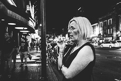 Nashville, Tennessee (G. L. Brown) Tags: blackandwhite bw woman monochrome bar contrast noir shadows nashville tennessee candid streetphotography smoking nightclub storefront signage grainy nashvillestreetphotography