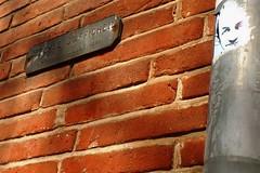 Le petit bonhomme... (mistigree) Tags: brique toulouse mur sarkozy visage interdit