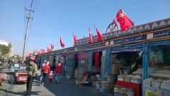 中國共產黨的國旗插在了新疆伊寧市漢人街的商店大門旁。。這是做給誰的呢? (xiaozhangzhuang) Tags: china xinjiang 新疆 中國 共產黨 伊宁市