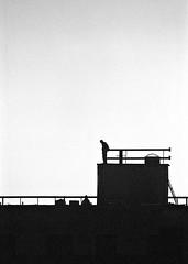 Early morning at the construction site (saxild) Tags: nikon f80 n80 nikkor 180mm 180mm28 kodak tmax tmax400 400 push800 800 opticfilm 7600 negativ scanner analog film morning constructionsite silhuet silhuette worker man copenhagen denmark