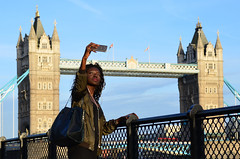 Tower bridge selfie (Phototravelography) Tags: england london gb uk towerbridge riverthames selfie lady woman girl lips streetportrait streetphotography fcc album people pretty telephone camera red blue tourist