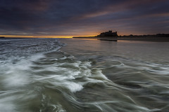 Bamburgh (Pureo) Tags: bamburghcastle northeast northumberland northsea water waterscape waves seascape sea sky sunrise dawn landscape canon canon6d canondslr