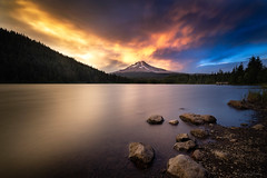 Front Row Seat (_JonathanMitchellPhotography_) Tags: longexposure sunset red summer mountain lake snow storm mountains tree art clouds oregon rocks artist cloudy sony mthood pacificnorthwest westcoast trilliumlake burningclouds longexposurephotography a7r jonathanmitchell
