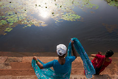 Saris. Gokarna, India (Marji Lang Photography) Tags: life travel light two people sun india lake reflection colors composition outdoors photography clothing pond women colorful village bright lotus indian traditional streetphotography documentary sunny indians gokarna colourful dailylife karnataka adjusting inde saris ghats pilgrims streetshot ghat villagelife sarees indianwomen travelphotography gokarn twopersons 2013 holypond marjilang gokarnapond