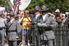Confederate Flag Removed from South Carolina Capitol Grounds (Richard Ellis Photography) Tags: usa horizontal america unitedstates symbol massacre flag unitedstatesofamerica capital ceremony southcarolina columbia confederate capitol crime folded lower hatred removal racism racist civilrights ame symbolic carrying statehouse policemen lowering honorguard statepolice highwaypatrol battleflag massmurder charlestonnine emanuelafricanmethodistchurch