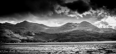 The Scottish Highlands BW-7 (broadswordcallingdannyboy) Tags: bw holiday storm clouds mono scotland blackwhite highlands dramatic loch wilderness dramaticsky canoneos torridon lochtorridon westernhighlands canonlens bwscotland scottishloch northwesthighlands leonreilly eos7d dramaticlandscapes lightroom4 leonreillyphotography copyrightleonreillyphotography scottishhighlandsbw