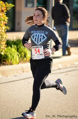 I run while you wait (Dr. M.) Tags: dedication race nikon pretty young running strong athlete runner focused 5k lycra d7000