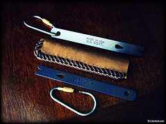 Titaniuim widgy bars and leather laced sheath (Stormdrane) Tags: door make leather bar pen diy keychain keyring key loop lock lace knife tie craft knot hobby double needle howto stitching straight pocket edc curved titanium ti weave braid scouting pry fob gaucho everydaycarry lanyard attach laced widgy beprepared monkeyfist turkshead prybar flashllight countycomm stormdrane