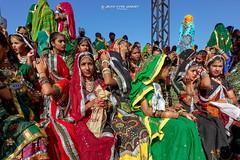 Jeunes Filles d'une ecole de danse   Pushkar (Rajasthan -Inde) - Group Dance by School girls in Pushkar (Rajasthan - India) ( Jean-Yves JUGUET ) Tags: portrait india girl beauty face look festival photography eyes asia desert front camel pushkar hindu hinduism gypsy pilgrimage pilgrim inde frontview colorimage camelfair thardesert
