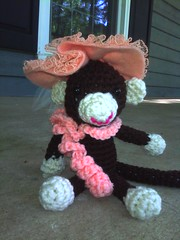 Georgina the crochet monkey sitting on the front porch awaiting a mint julep (crochetbug13) Tags: crochet crocheted crocheting crochetmonkey amigurumimonkey sussexacres frontporch raleigh northcarolina