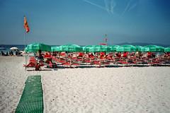 (Monica Forss) Tags: minoltaprod20s film analog 35mm italy italia sardegna sardinia alghero beach summer sand people sea water parasol