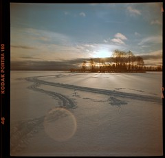 Traffic on the frozen lake - LOMO (cotnari73) Tags: winter sweden storsjö sandviken lomo analog analogue lubitel166b kodakportra160 russian sovjet retro vintage lomography mediumformat