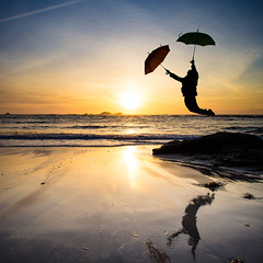 Youpi! (Zeeyolq Photography) Tags: beach bretagne flying happy joie jump mers oceans parapluies plages sauter sunset umbrella water plouarzel france