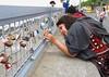 Georgina and Sharma on the Manila sea wall 0095 (Tony Withers photography) Tags: tonywithers philippines 2017 mallofasia moa seawall manilabay locks fence padlocks wishes love lovelocksinmanila