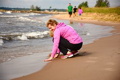 Testing the water (Bubash) Tags: beach sand michigan upperpeninsula greatlake familyvacation manistique
