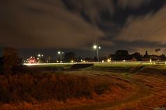 An evening in Westzaan (PhotoTJH) Tags: road street longexposure nightphotography night clouds dark photography lights fotografie traffic nacht streetlamps wolken weg donker nachtfotografie straat verkeer lichten assendelft westzaan straatlantaarns guisveld lantarenpalen n246 n515 westzaannoord phototjh phototjhnl