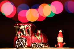 Hey, hop aboard!! (Xenofon Levadiotis) Tags: santa christmas light tree home night train canon lights photo bokeh decoration christmastree greece round santaclaus hop merry claus noracism 135mm aboard