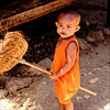 Petit guerrier (Pimenthe) Tags: child young kid baby angry fun funny colorful orange nice cute fight fighting arm weapon asian person portrait east island travel life man living tradition poor colour photo photography journalism sun sunny