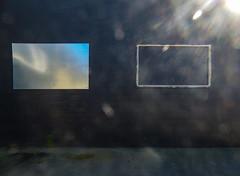 A Light Shower (Steve Taylor (Photography)) Tags: wall blue black green white metal newzealand nz southisland canterbury christchurch cbd city moss reflection shiny light weeds lensflare