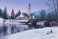 while feeding the ducks (cherryspicks (on/off)) Tags: snow landscape church lake bohinj slovenia ducks water evening bench ribcevlaz baptist travel bridge